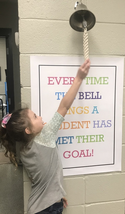 Aslyn ringing the bell